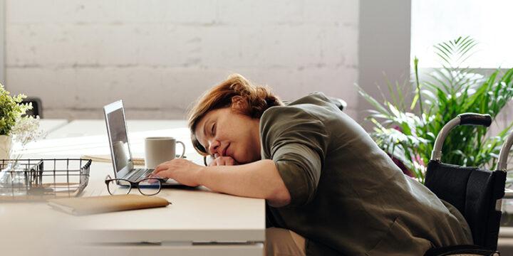 woman sleeping on desk