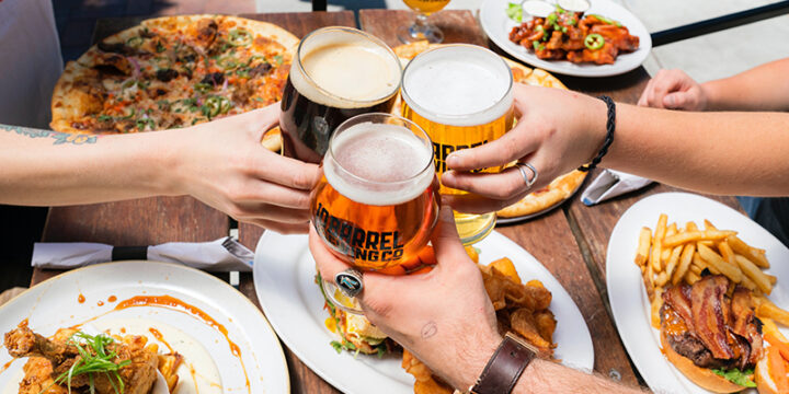 friends enjoying lunch with beer